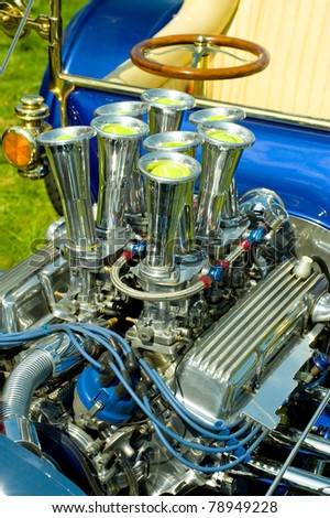 customized and chromed hot-rod vehicle engine with tennis balls in the air inlets - stock photo