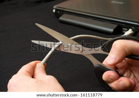 cut a piece of the network cable from the laptop - stock photo