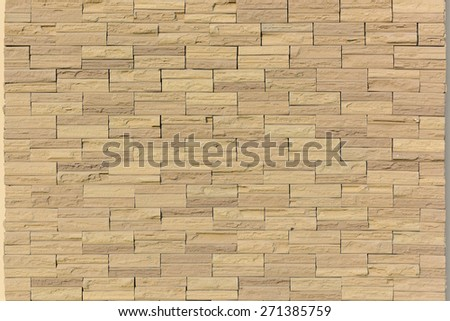 Cut a rectangle of sand stone natural gold to decorate the wall with a suitable exterior wall or fence. or Sand stone brick wall,texture background. - stock photo