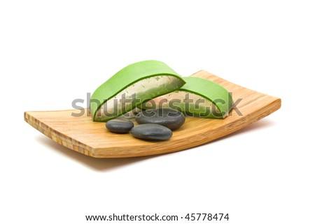 Cut aloe vera leaf in spa arrangement - stock photo