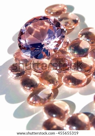 cut and poured glass ornaments in bright sunshine - stock photo