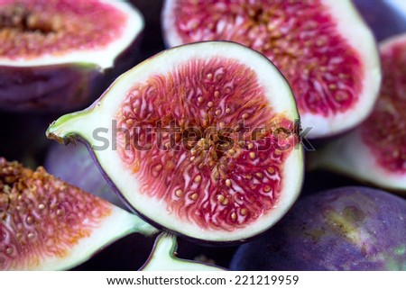 Cut and whole figs. (Small depth of field.) - stock photo