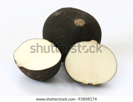 Cut black radish halves on grey background - stock photo