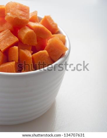 cut carrot on white - stock photo