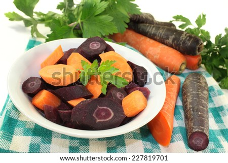 cut carrots in a white bowl against white background - stock photo