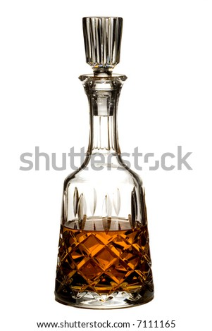 Cut crystal decanter of brandy or whiskey isolated on white - stock photo