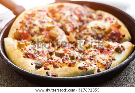 cut delicious pizza in a pan - stock photo
