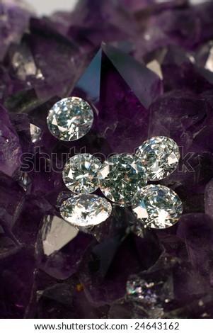Cut diamonds on lavender amethyst. - stock photo