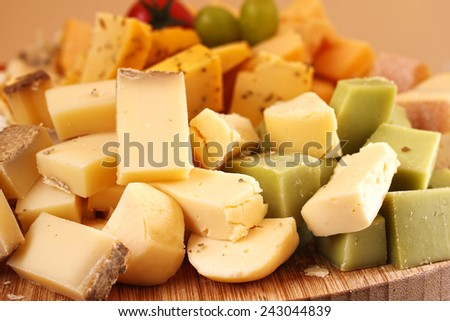 Cut french cheese blocks background close-up