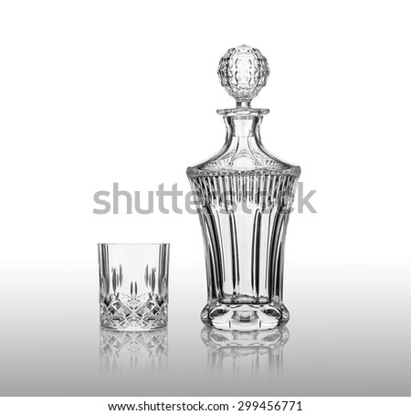 cut-glass decanter with a glass - stock photo