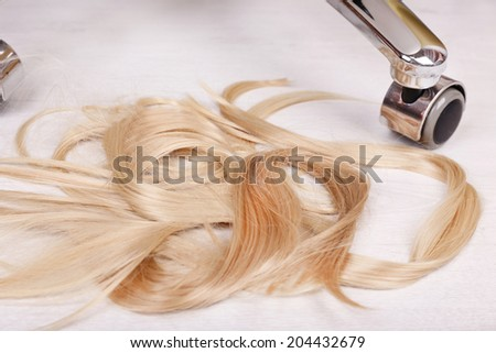 Cut hair on the floor in hairdressing salon, close up - stock photo