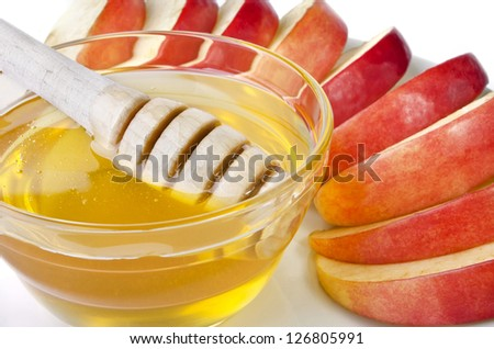 Cut into slices of apples with a bowl of honey, isolated over white. Illustration of Rosh Hashanah (jewish new year) or Savior of the Apple Feast Day