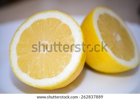 Cut lemon on plate - stock photo