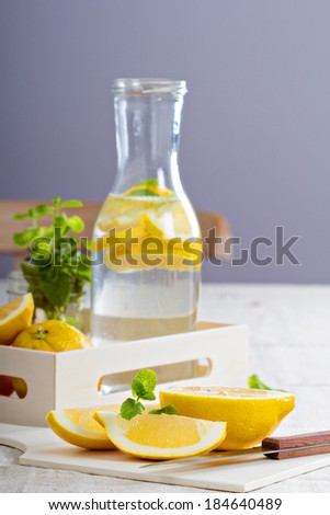 Cut lemons on a cutting board and lemonade