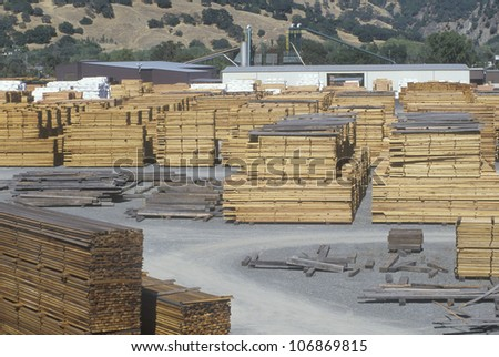 Cut lumber stacked at a lumber mill in Willits, California - stock photo