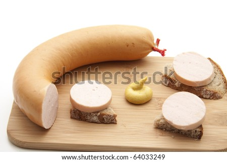 Cut meat sausage and with mustard