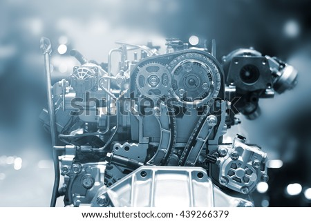 Cut metal car engine part, blue color tone - stock photo