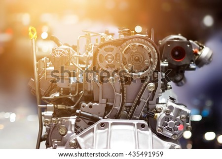 Cut metal car engine part, colorful concept - stock photo