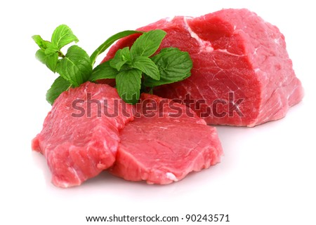 Cut of  beef steak with green leaf. Isolated. - stock photo