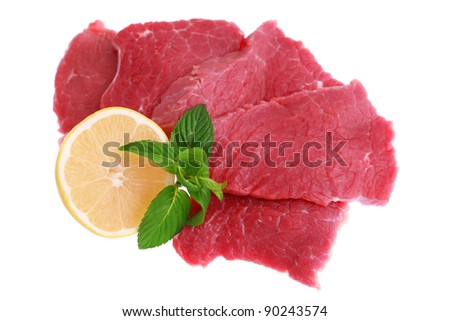 Cut of  beef steak  with lemon slice. Isolated. - stock photo