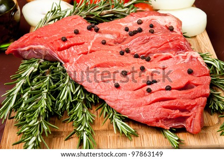 cut of meat on cutting board - stock photo