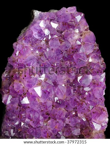 Cut of precious amethyst on a black background - stock photo