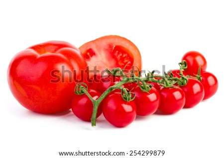 Cut on half  tomato and cherry tomatoes branch over the white background - stock photo