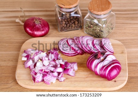 Cut onion on cutting board on wooden background