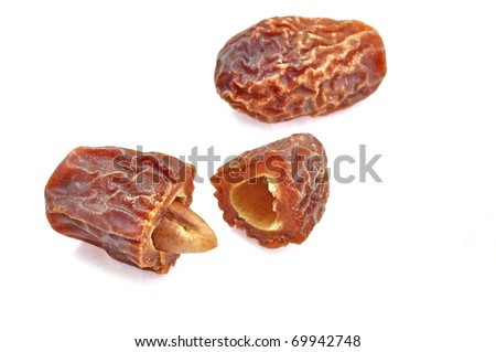 cut open dried dates isolated on white background