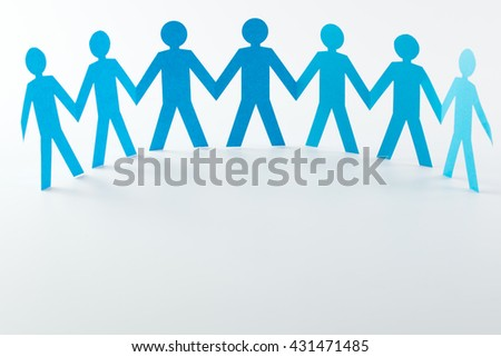 Cut out of blue paper people form in a semi circle - stock photo