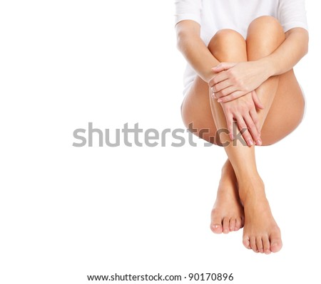 cut out slender naked female legs being massaged isolated on white - healthcare and beauty concept - stock photo