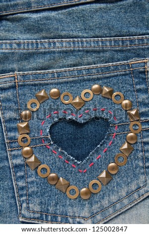 Cut out the shape of heart on denim fabric