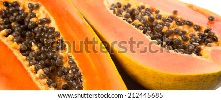 Cut papaya fruit over white background - stock photo