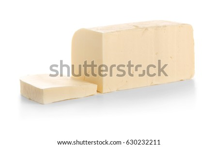 Cut piece of butter on white background