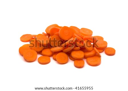 Cut pieces of carrots over white background - stock photo