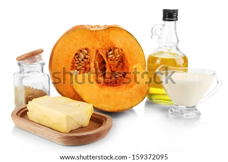 Cut pumpkin with ingredients for cooking isolated on white - stock photo