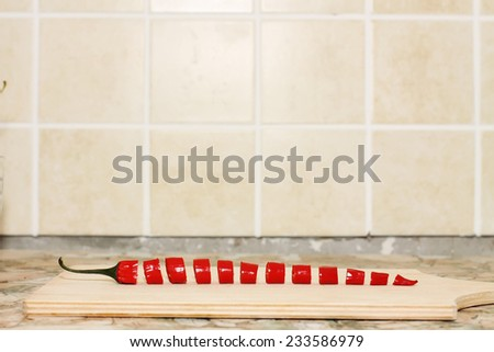 cut red hot chili peppers - stock photo