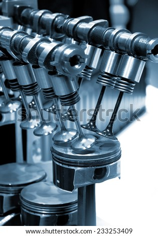 Cut section of automotive pistons and valves - stock photo