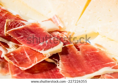 cut slices of ham (panish jamon iberico) and cheese - stock photo