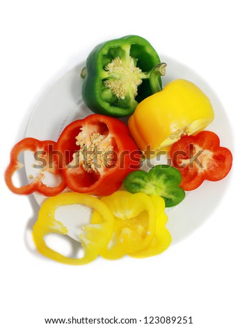 cut sweet peppers on the plate isolated