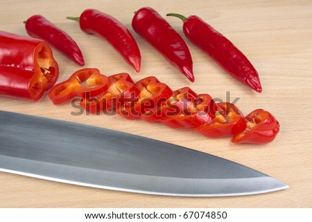 Cut Sweet red peppers and chillies selection - stock photo