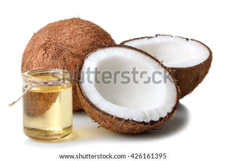 cut the coconut and coconut oil in a small glass jar on a white isolated background - stock photo