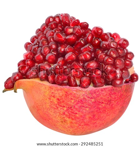 Cut the pomegranate with heap grain isolated on white background. - stock photo