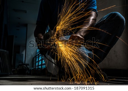 cut the steel rod using grinding machine - stock photo