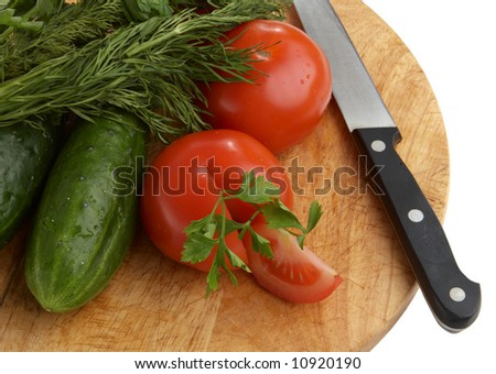 Cut tomato, cucumbers, fennel and knife - stock photo