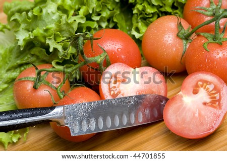 Cut tomato on  board.Fresh vegetable.Vegetarian food background