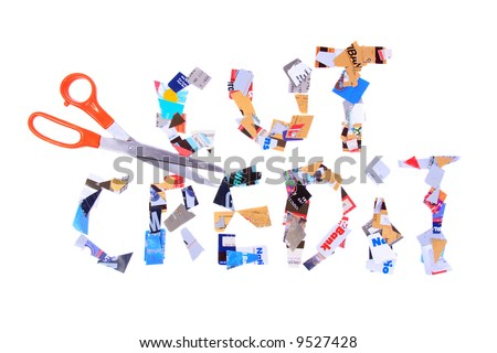 Cut up credit cards with a pair of scissors spelling out cut credit.