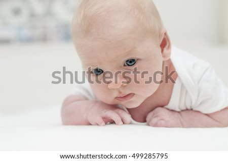 Cute adorable newborn blonde baby with blue eyes portrait