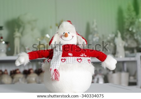 Cute adorable stuffed toy snowman with opened arms ,Christmas concept in store  - stock photo