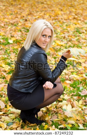 cute adult  girl posing at autumn park